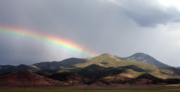 Desert storm and rainbow